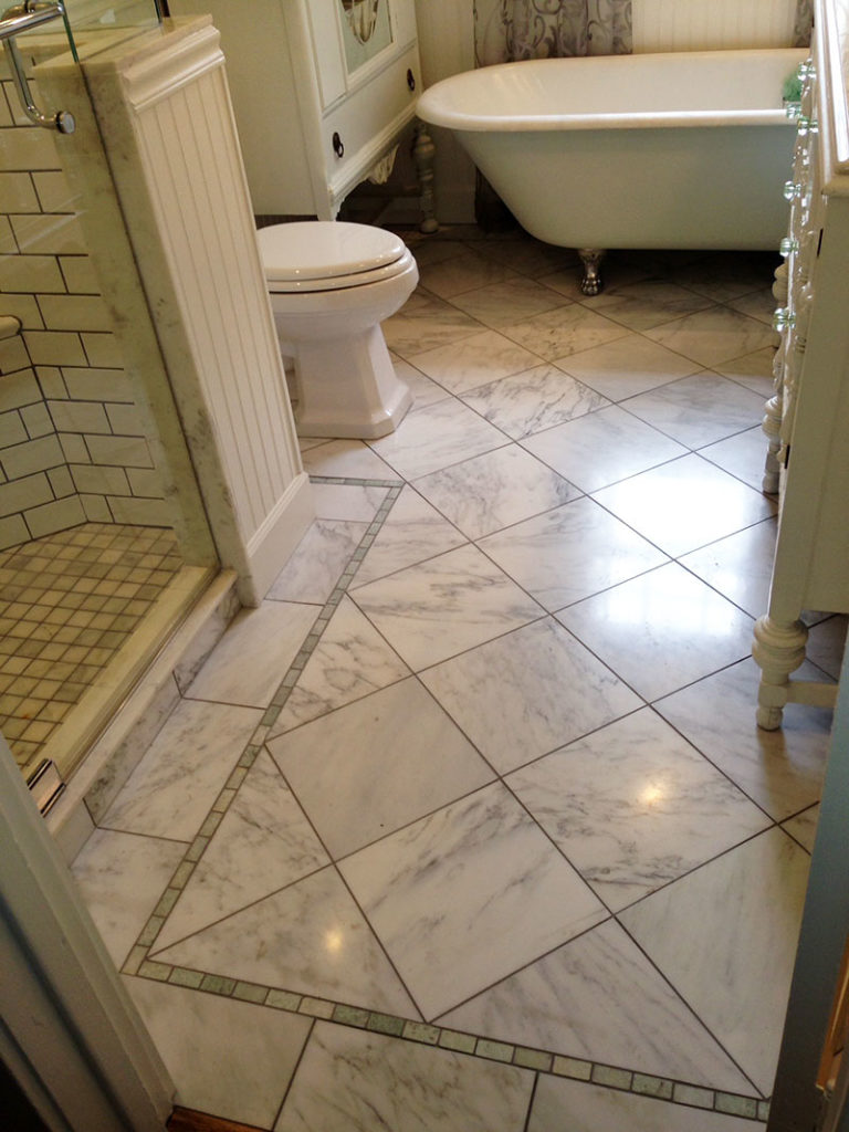The marble floor with Ming Green marble border has in-floor heating. It's wonderful. :-)