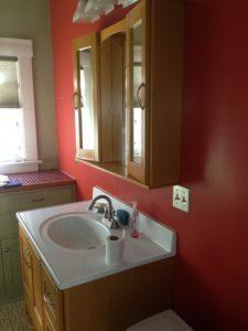 """Updated"" vanity in bathroom"